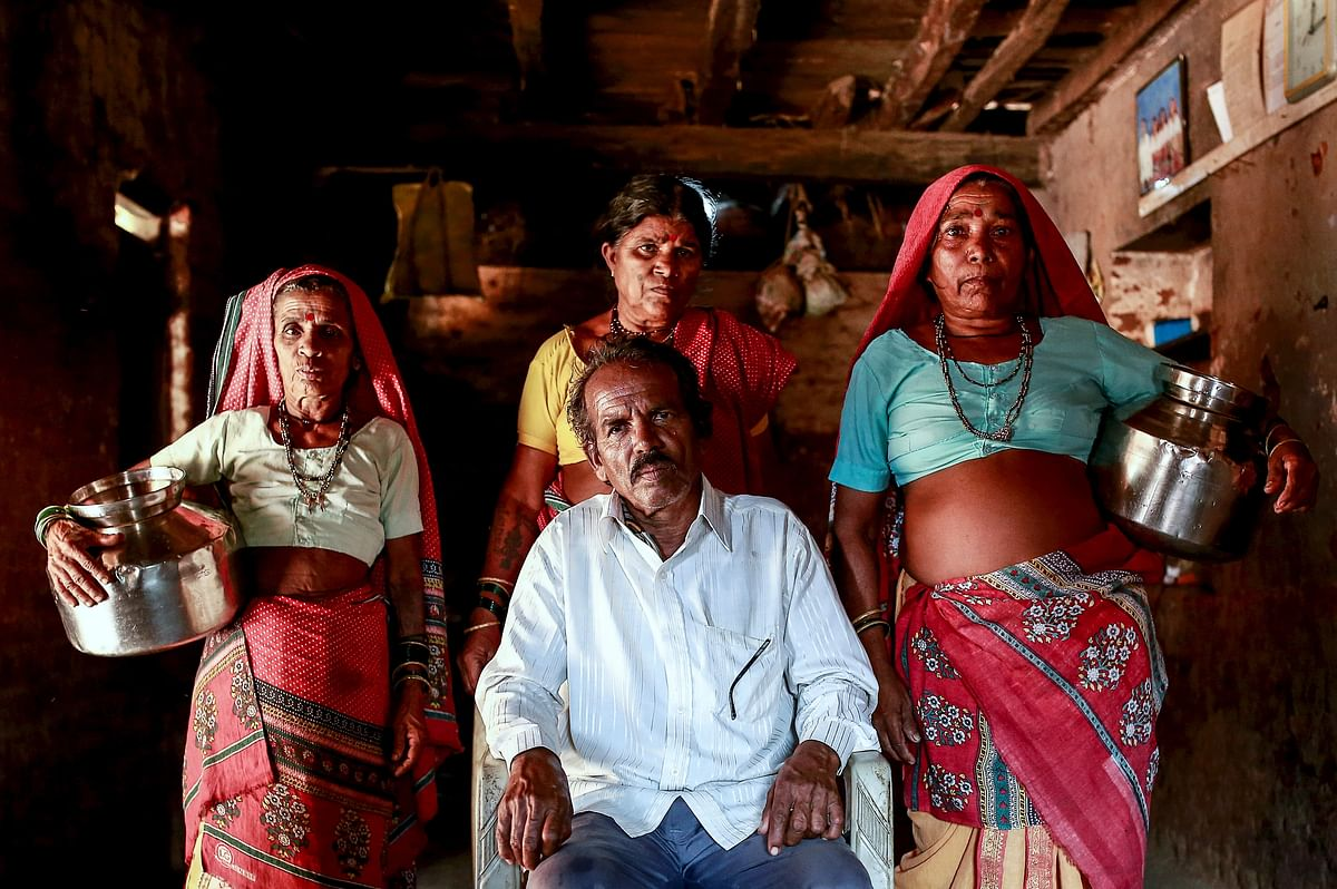 Sakharam Bhagat, 66, poses with his wives, Sakhri, Tuki and Bhaagi (L to R) inside their house in Denganmal village, Maharashtra, India, April 20, 2015. (Photo: Reuters)
