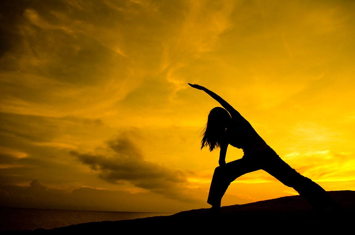 If you're thinking about trying yoga, you don't need to touch your toes from day 1. The only thing you need is an open mind. (Photo: iStock)