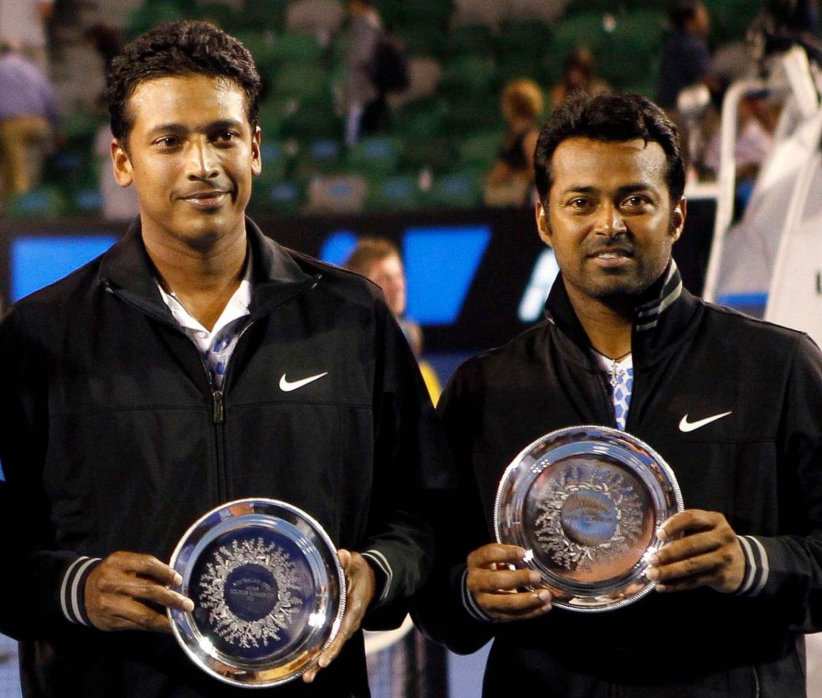 Mahesh Bhupathi and Leander Paes (R) of India pose with their trophies after their men's doubles final match against Bob Bryan and Mike Bryan of the U.S. at the Australian Open tennis tournament in Melbourne. (Photo: Reuters)