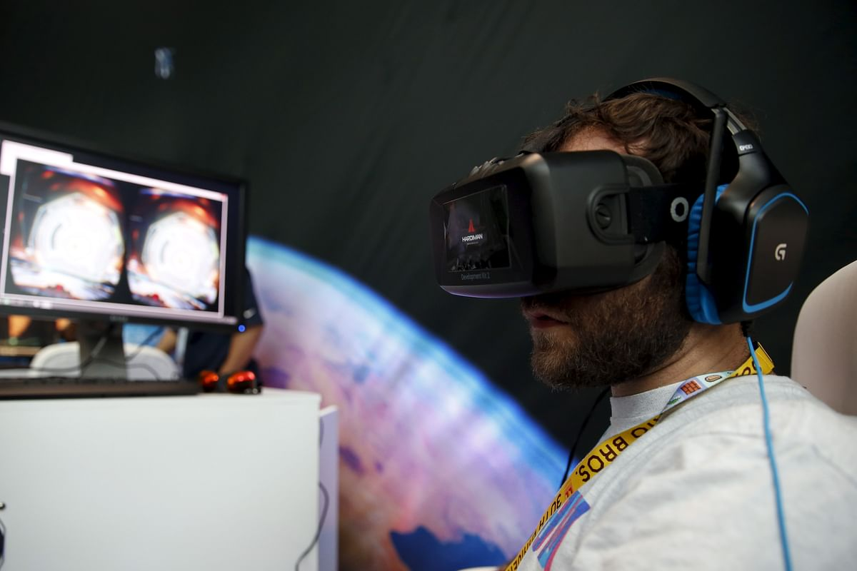 """A man wears an Oculus VR headset as he plays Three One Zero's """"Adrift"""" video game. (Photo: Reuters)"""