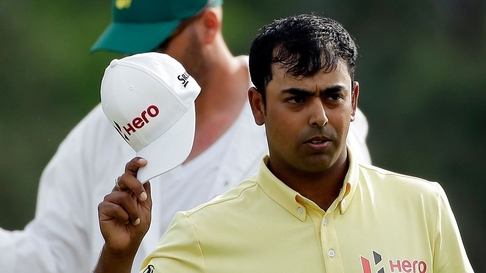 Anirban Lahiri waves to the gallery on the 18th hole during the second round of The Masters. (Photo: AP)