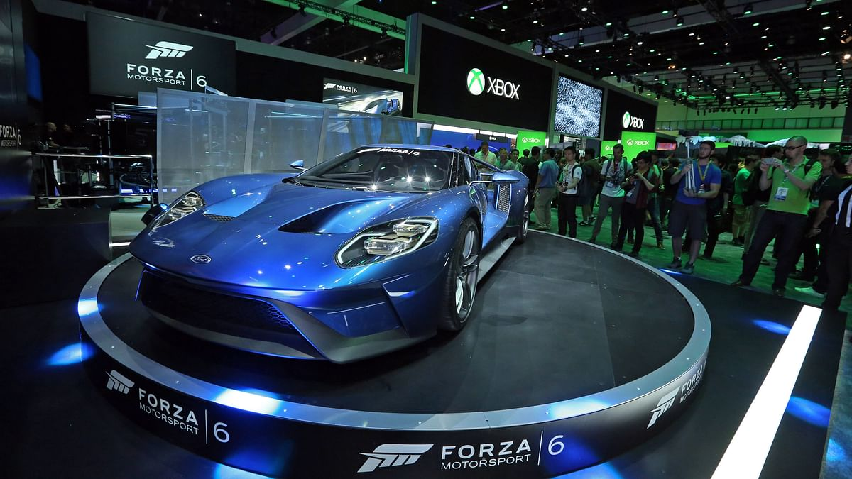 People check out the all new 2017 Ford GT alongside Forza Motorsport 6 at the Xbox booth at E3 in Los Angeles on Tuesday (Photo: AP)