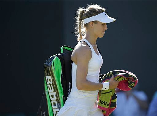 12th seed Eugenie Bouchard  walks off the courst after her shock 7-6 (3), 6-4 Round 1 loss.