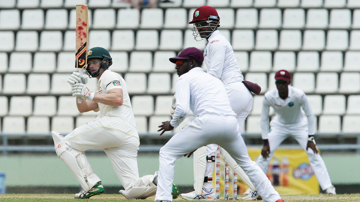 Australia's Adam Voges, left, bats on his way to score a century during the second day of their first cricket Test match against West Indies in Roseau, Dominica. (Photo: AP)
