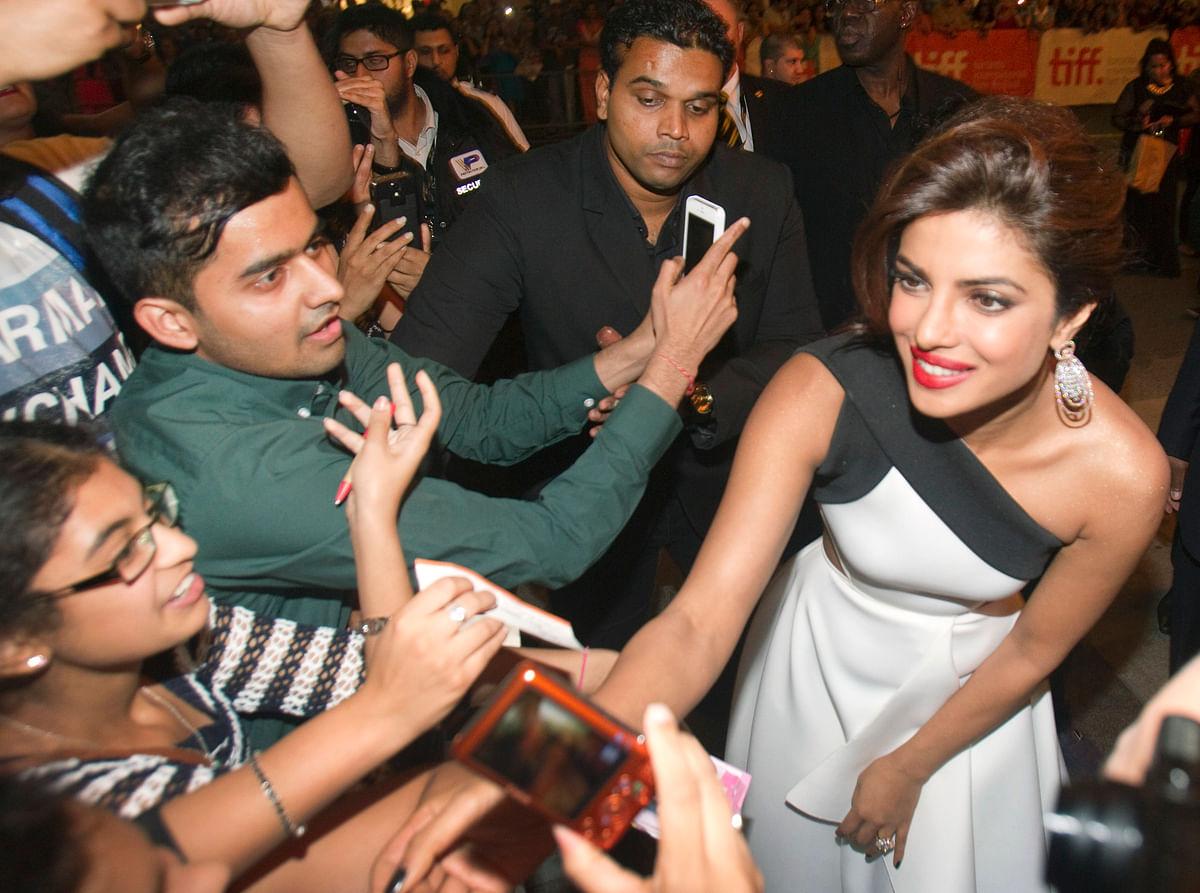 Priyanka Chopra with fans (Photo: Reuters)