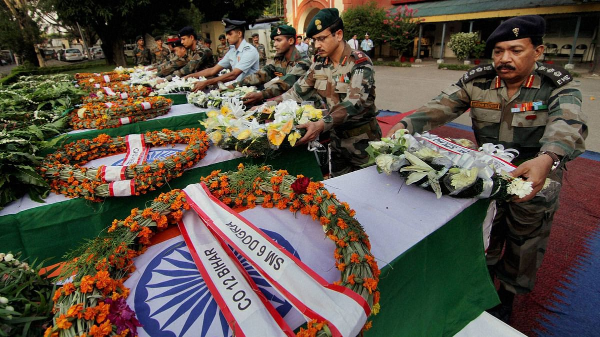 Army officers pay tribute in Jammu on Sunday to the soldiers killed in Thursday's ambush in Manipur. (Photo: PTI)