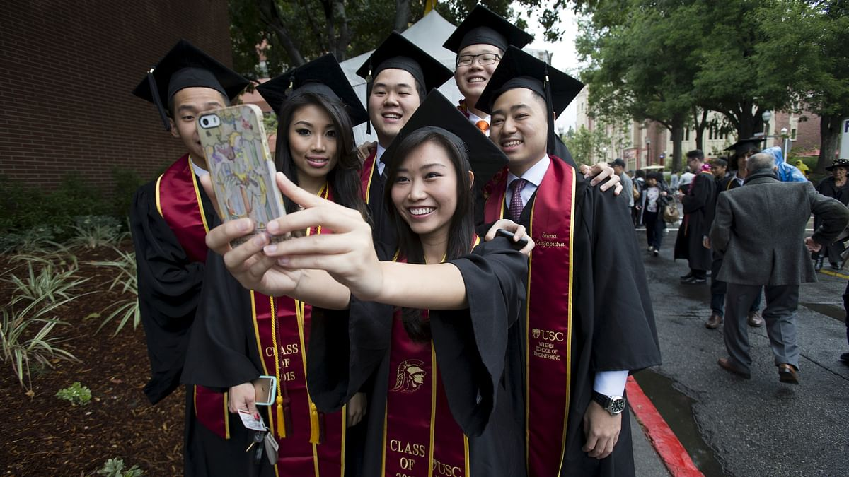 Graduating students take a selfie following USC's Commencement Ceremony at University of Southern California in Los Angeles, California May 15, 2015. (Photo: Reuters)