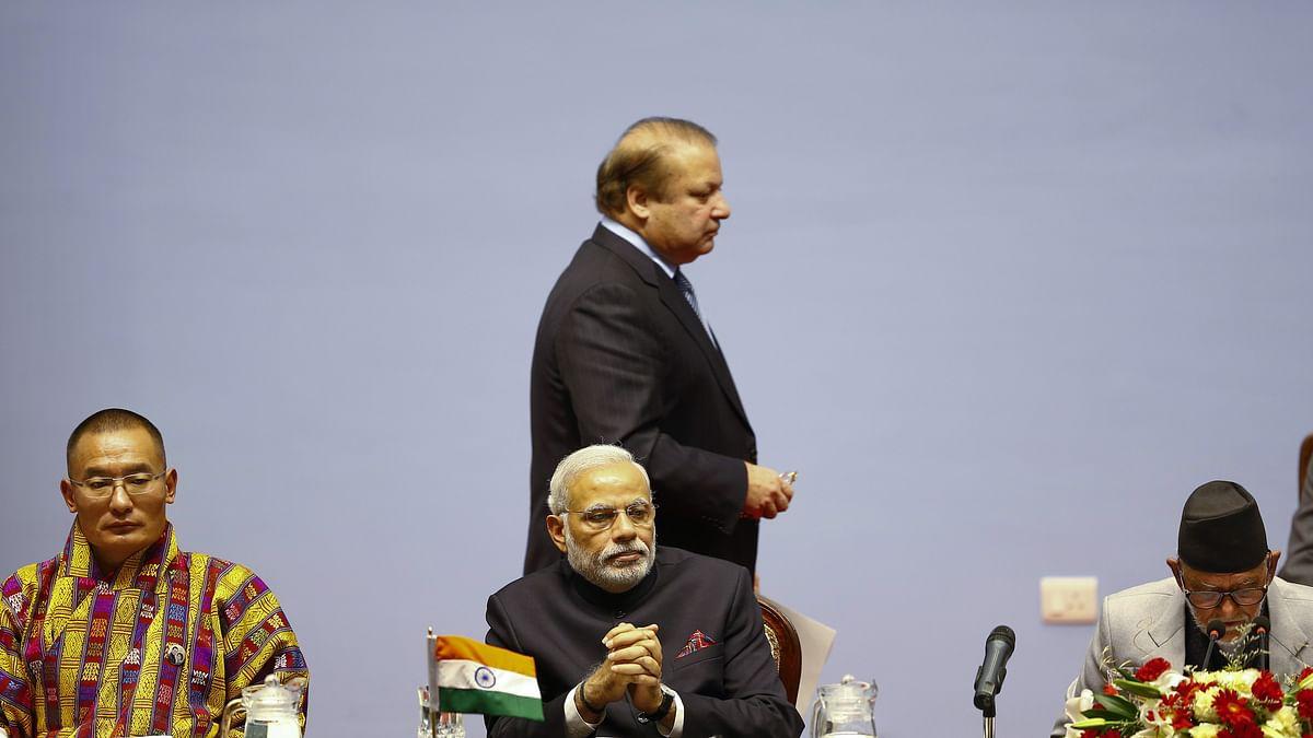 Prime Minister Nawaz Sharif walks past Prime Minister Narendra Modi. (Photo: Reuters)