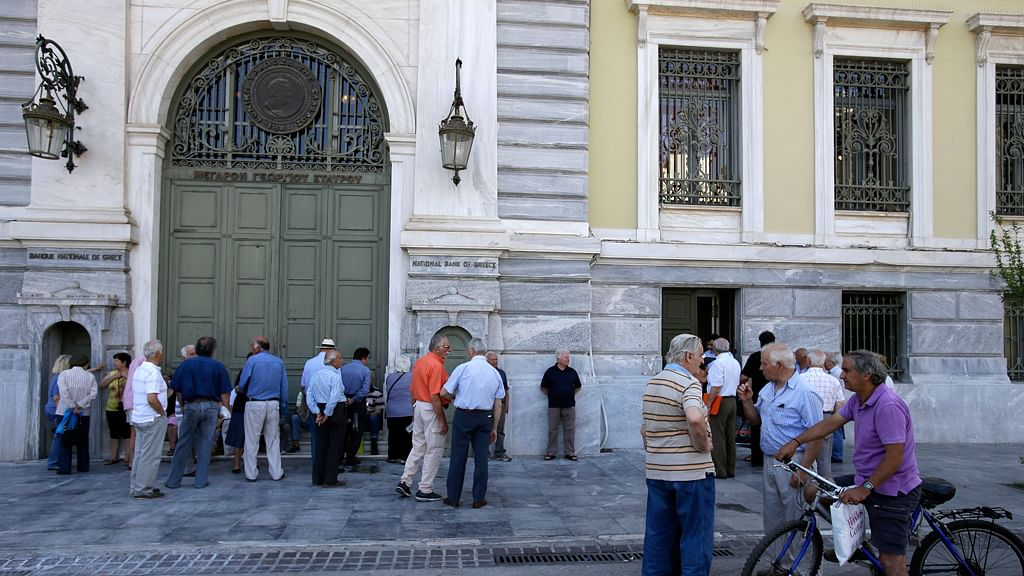 Elderly people, who usually get their pensions at the end of the month, wait outside a closed bank in Athens, Monday, June 29, 2015. (Photo: AP)