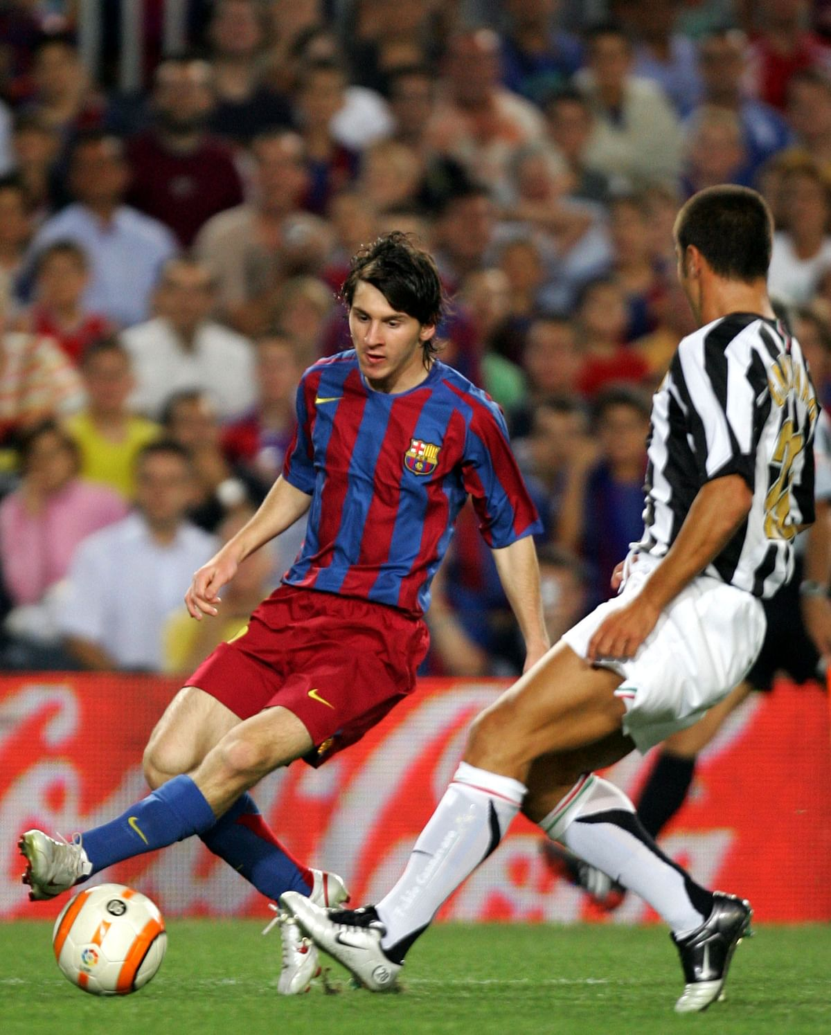 Barcelona's Leo Messi (L) of Argentina withJuventus' Fabio Cannavaro during a friendly soccer match for the Joan Gamper Trophy in Barcelona, Spain August 24, 2005. (Photo: Reuters)