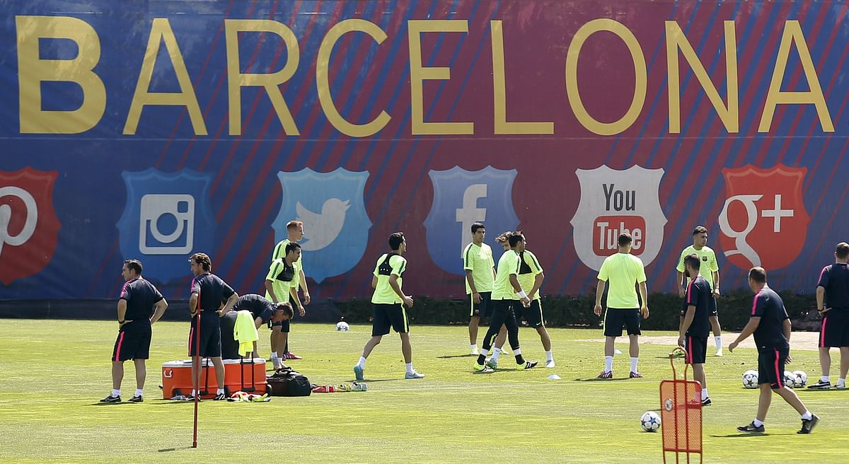 Barcelona's players attend a training session during the media Barcelona Open Day in Spain June 2, 2015, ahead of the Champions League final against Juventus on June 6.