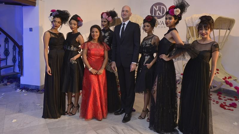 Fashion Designer Neeva Debnath (in red) along with models, and British Deputy High Commissioner Scott Furssedonn-Wood (fourth from R).