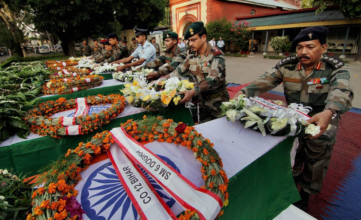 Army officers pay tribute to soldiers killed in Thursday's ambush in Manipur. (Photo: PTI)
