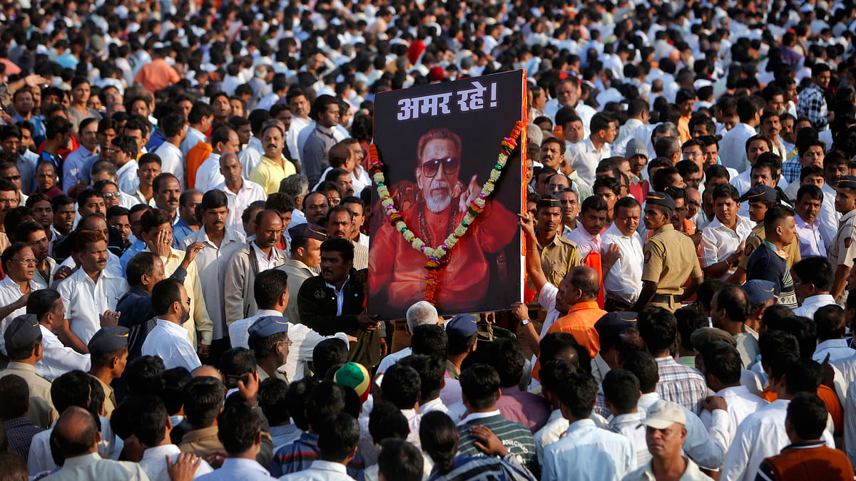 Shiv Sena supporters carrying a picture of late Bal Thackeray. (Photo: Reuters)