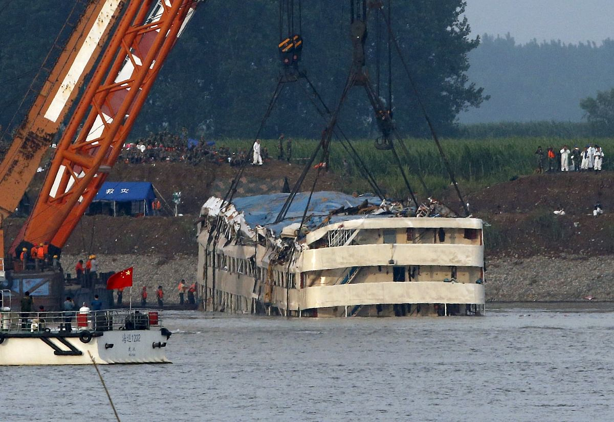 The Eastern Star, a cruise ship that sunk in the Yangtze River in Chinabeing pulled out of the water. (Photo: Reuters)