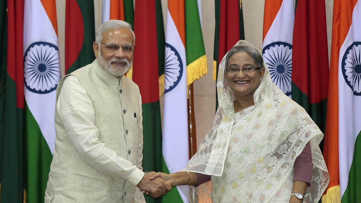 Prime Minister Narendra Modi shakes hands with Prime Minister Sheikh Hasina during his  visit to Bangladesh. (Photo: AP)