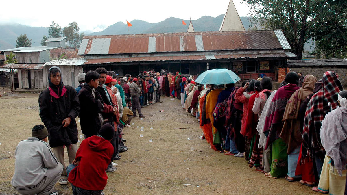 Voters stand in a queue outside a polling station at Ukhrul in Manipur. (Photo: Reuters)
