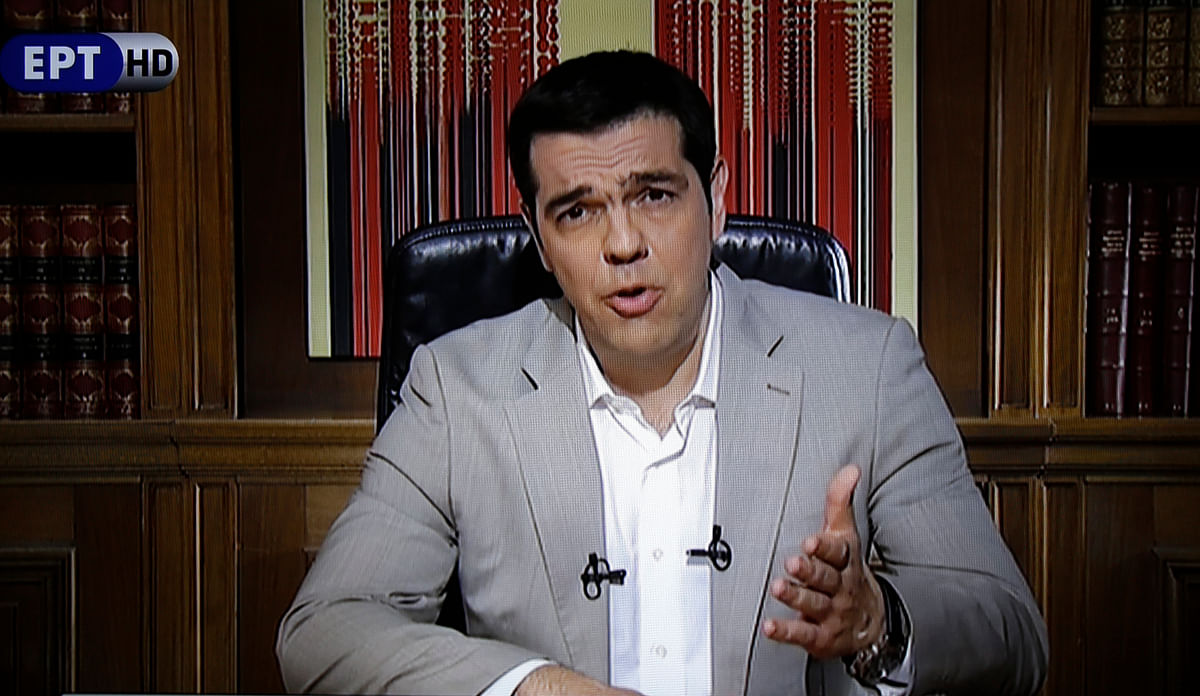 Greece's Prime Minister Alexis Tsipras delivering a televised address to the nation from his office at Maximos Mansion in Athens on Sunday. (Courtesy: ERT State Television)