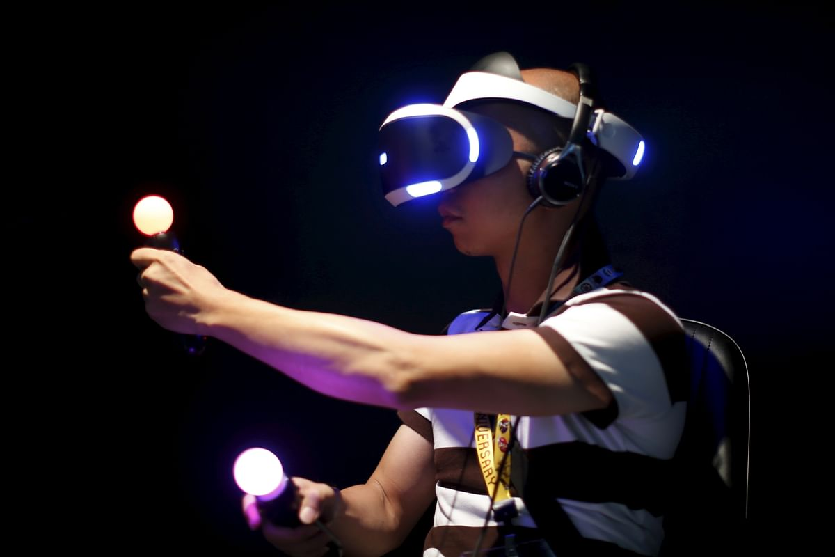 """A man plays Sony's Project Morpheus """"London Heist"""" video game with a virtual reality headset and move controllers at the Sony PlayStation booth. This is next level gaming for PlayStation gamers. (Photo: Reuters)"""