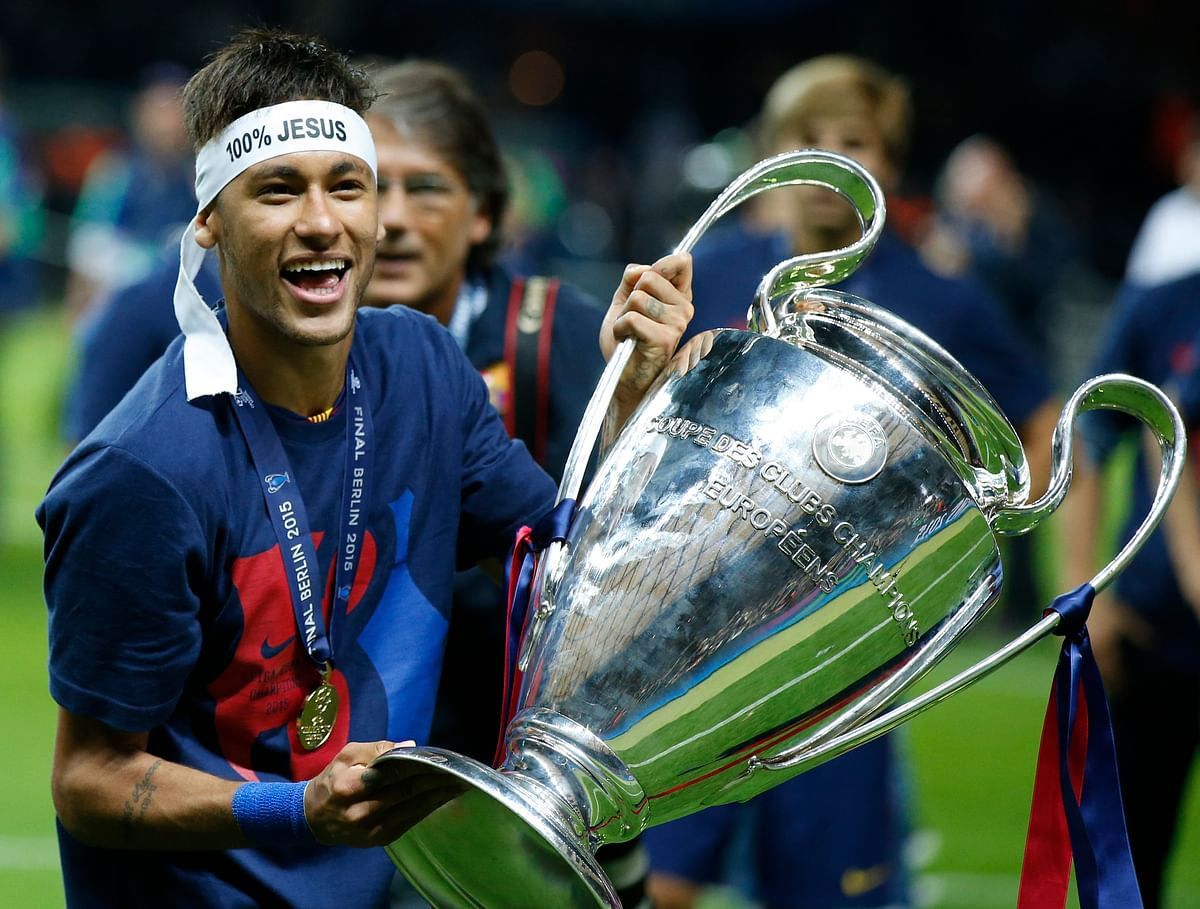 Barcelona's Neymar celebrates with the Champions League trophy after the final against Juventus. (Photo: AP)