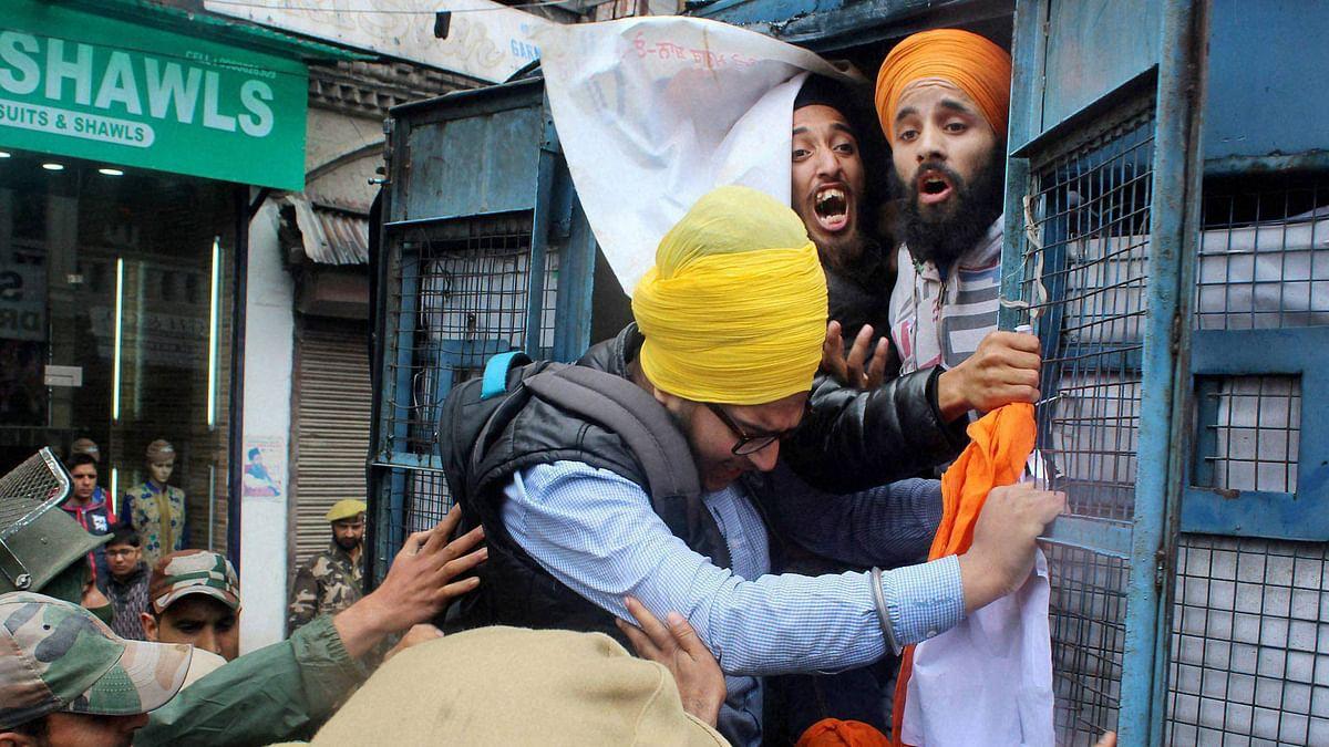 Police take Sikh youth into custody. (Photo: PTI)
