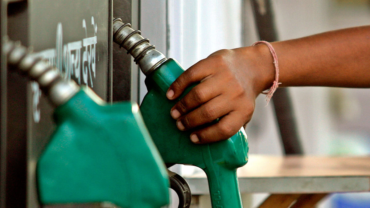 A worker lifts a petrol nozzle. Photo used for representational purpose. (Photo Courtesy: Reuters)