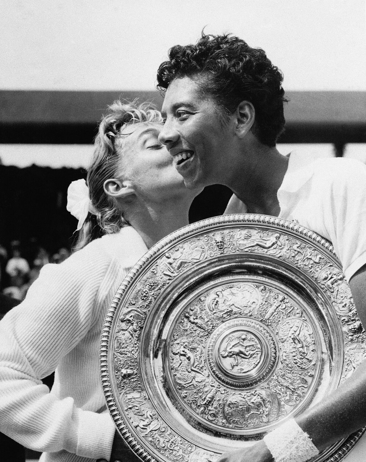 In this July 6, 1957 photo, Althea Gibson became the first black player, male or female, to win Wimbledon when she defeated fellow American Darlene Hard in the final. She ended up with five Grand Slam singles titles, (Photo: AP)<a></a>