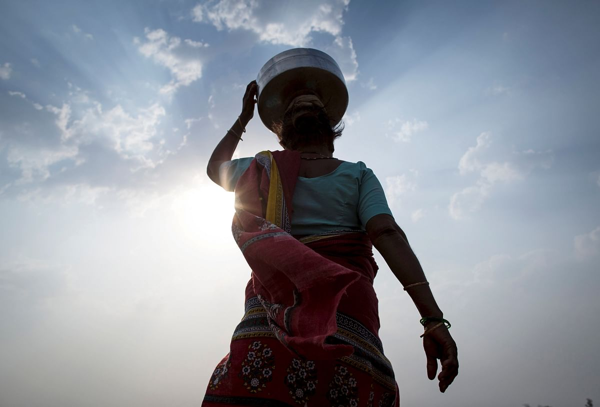 Bhaagi, third wife of Sakharam Bhagat, carries an empty metal pitcher as she walks to fetch water from outside her village in Denganmal, Maharashtra, India, April 20, 2015. (Photo: Reuters)