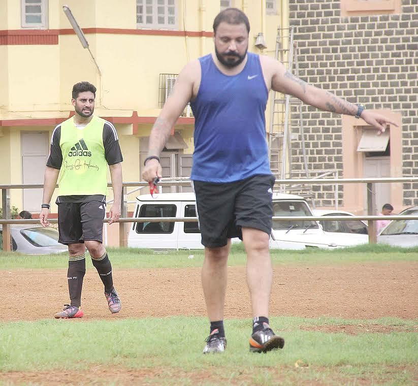Abhishek Bachchan and Bunty Walia playing football (Photo: Yogen Shah)