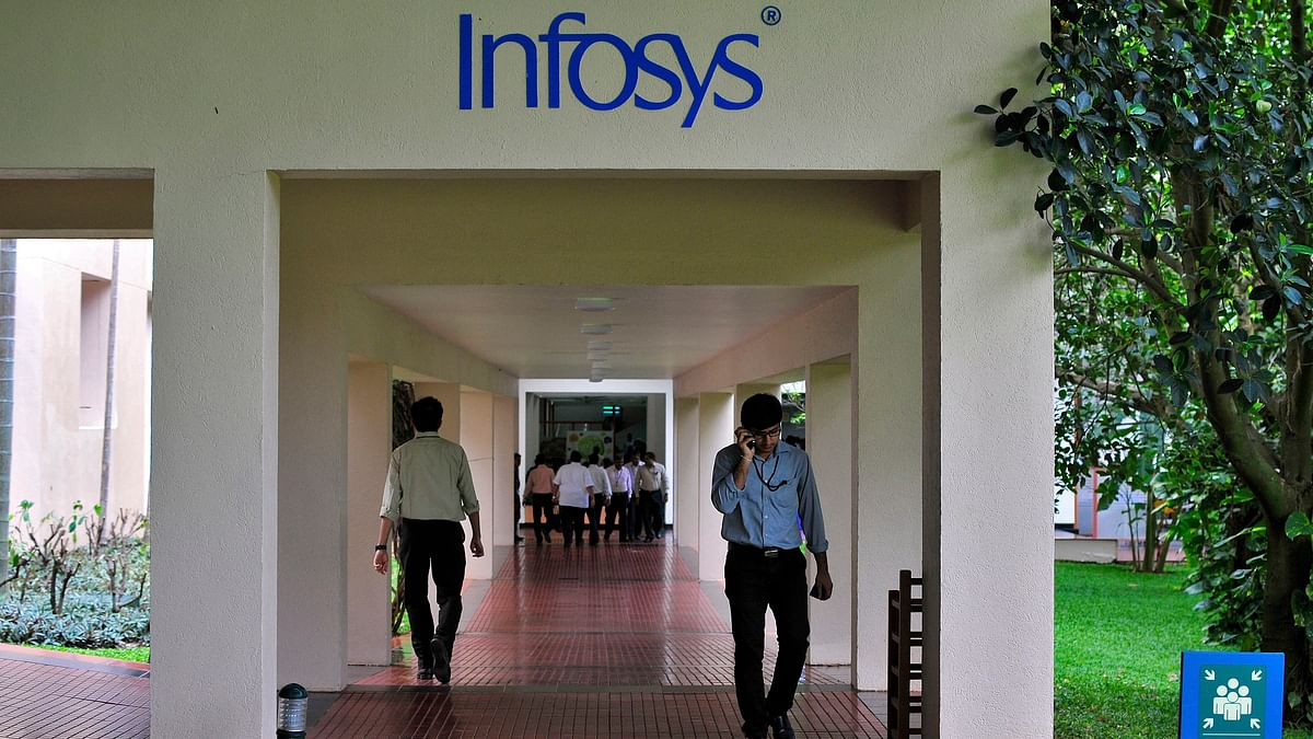 Employees walk along a corridor in the Infosys campus. Image used for representation.