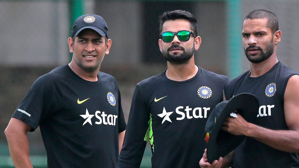 Indian skipper MS Dhoni with Virat Kohli and Shikar Dhawan at a nets session on Wednesday. (Photo: AP)