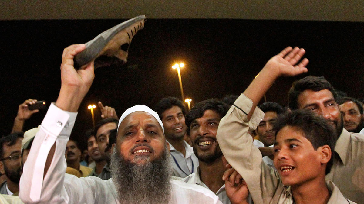 Pakistan cricket fans staging protest outside Allama Iqbal International Airport in Lahore in 2010.