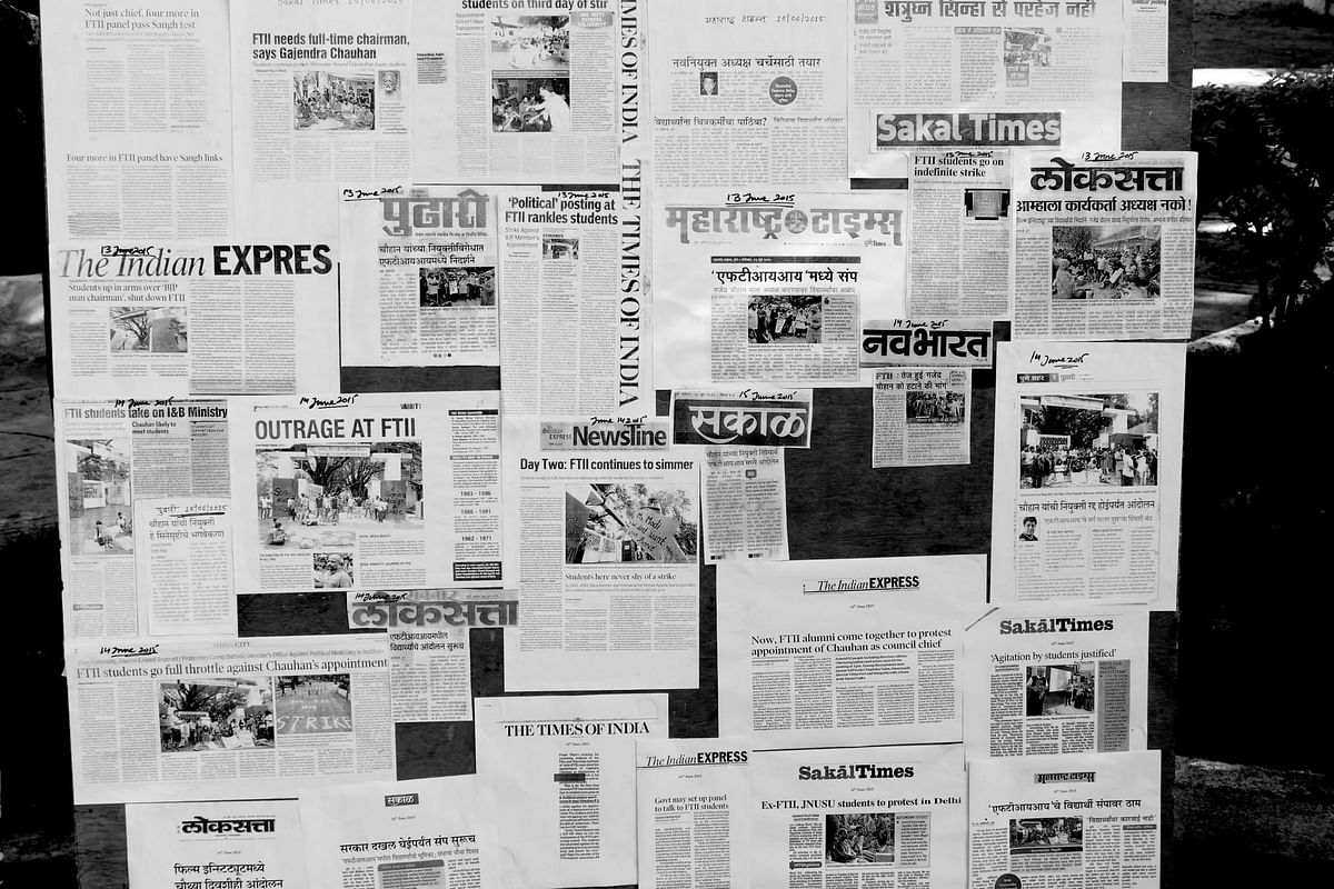"""A collage of newspaper reports of the strike at FTII put up on a wall (Photo: <span style=""""font-size: 14.0000400543213px; line-height: 17.9999923706055px;"""">Facebook/FTIIWisdomTree)</span>"""