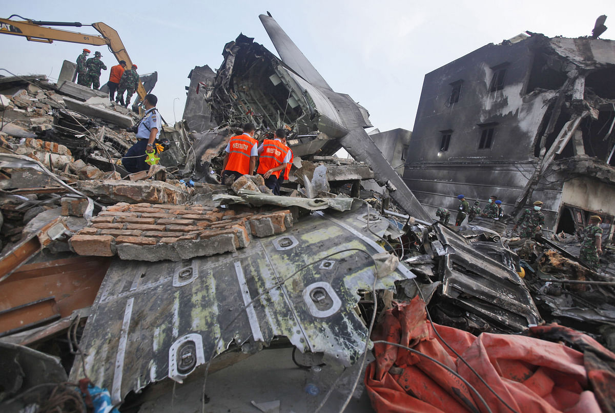 Investigators inspect the wreckage of the crashed air force transport plane in Medan in Indonesia. (Photo: AP)
