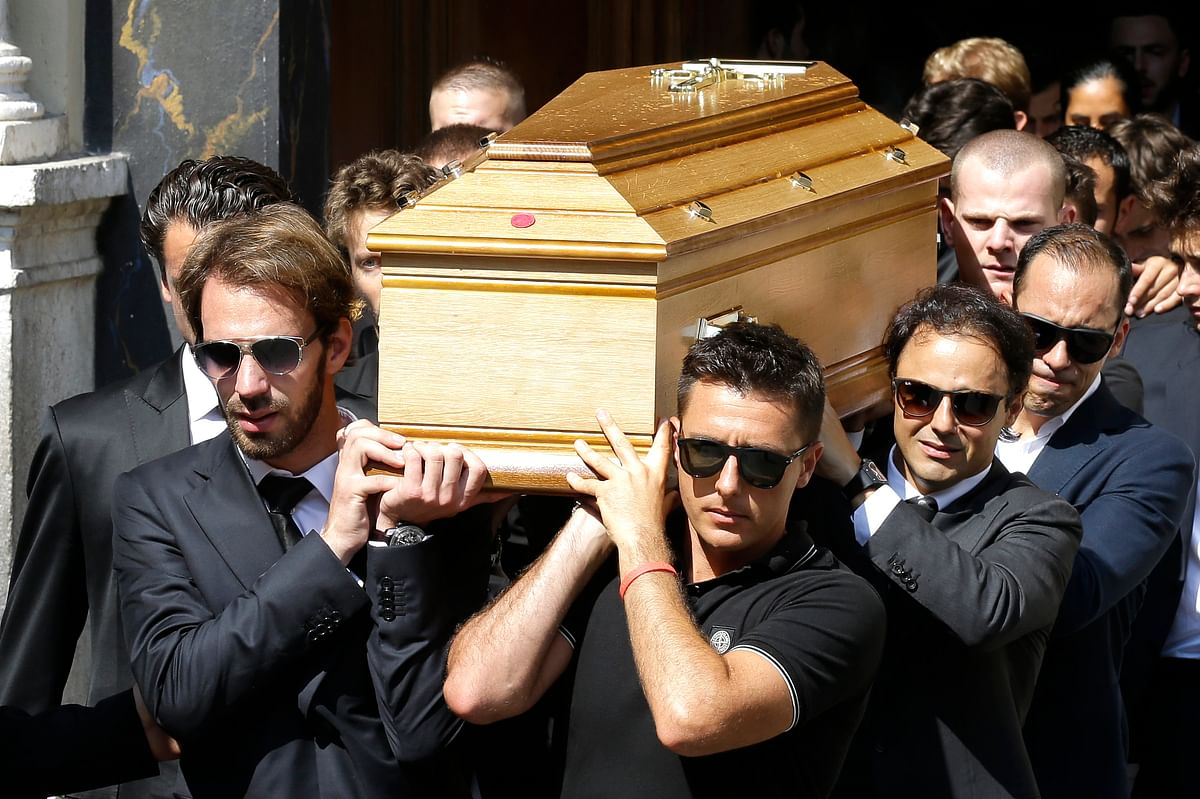 Formula One driver Jean Eric Vergne, left, Brazilian Formula One driver Felipe Massa, second right, and Venezuelan Formula One driver Pastor Maldonado, right, carry Bianchi's casket into Sainte Reparate Cathedral during his funeral in Nice, French Riviera. (Photo: AP)