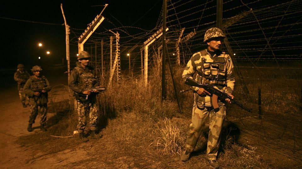 Indian Border Security Force (BSF) soldiers on night patrol near the fenced border with Pakistan. (Photo: Reuters)