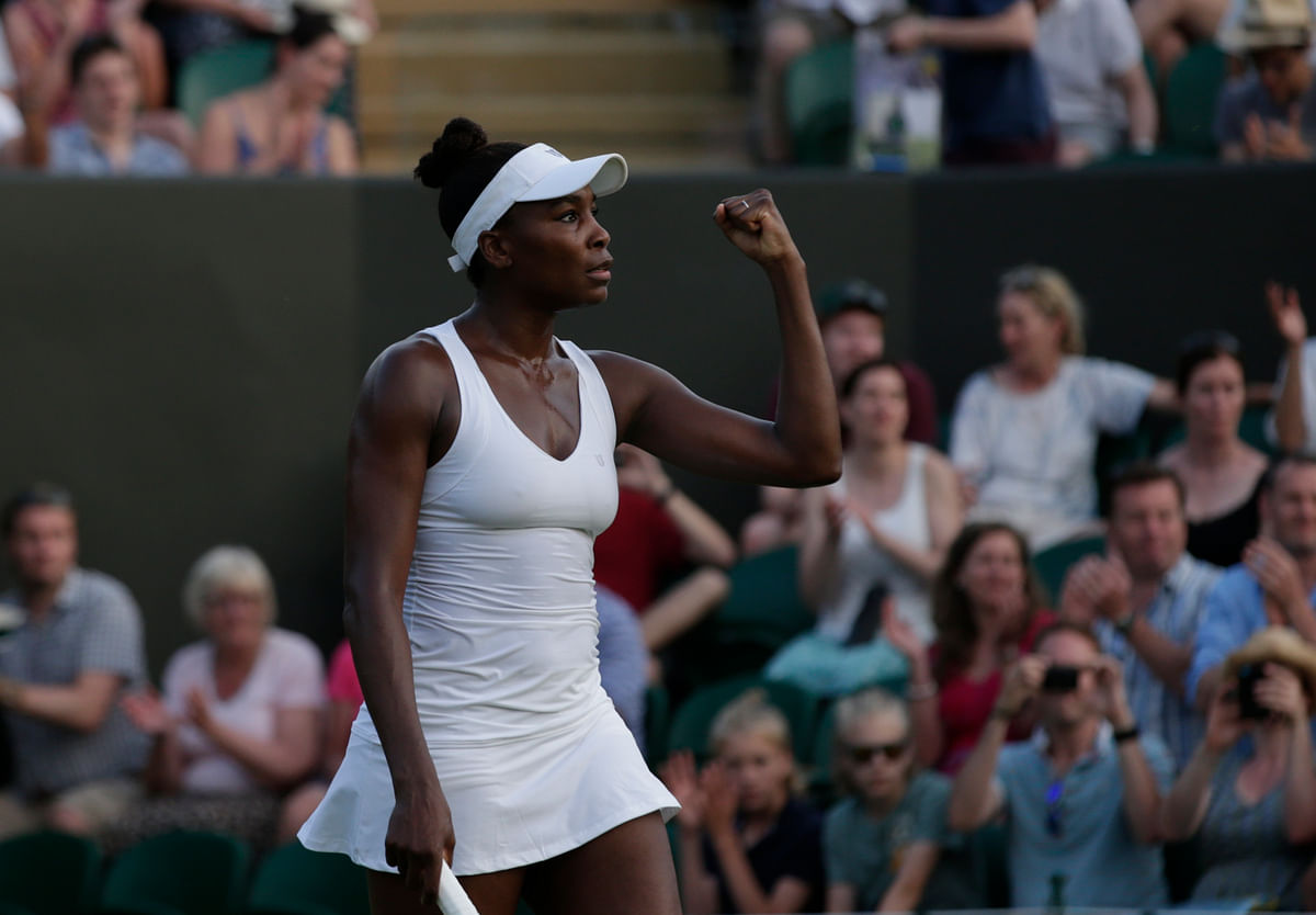 Venus Williams of the United States celebrates defeating Yulia Putintseva of Kazakhstan, during their singles match at the All England Lawn Tennis Championships in Wimbledon. (Photo: AP)