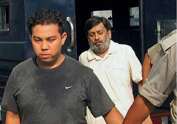 Rajesh Talwar and Krishna, who worked as a compounder for the Talwars, in police custody.