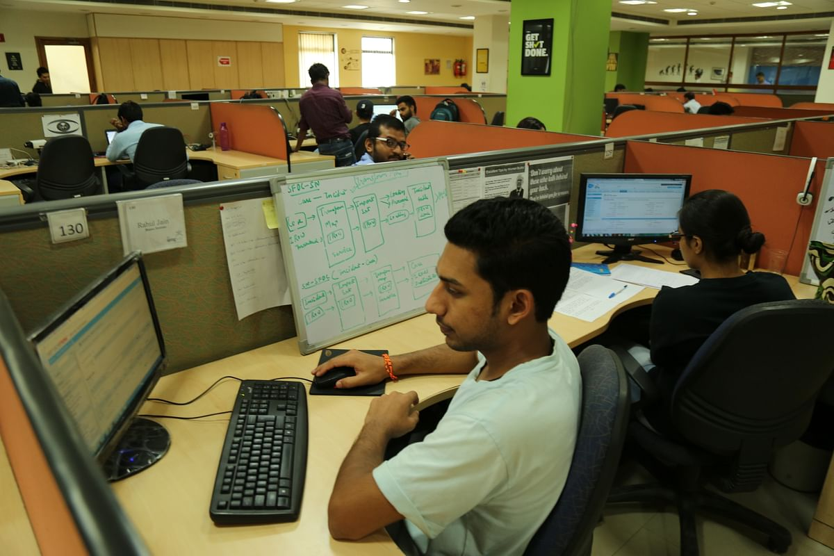 A regular day at 91springboard, a co-working space where different teams sit in adjacent cubicles. (Photo: The Quint)