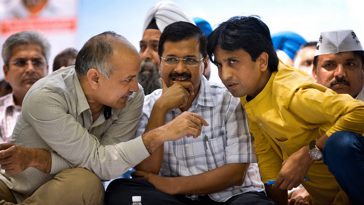 """Delhi CM Arvind Kejriwal with Deputy CM Manish Sisodia and party leader Kumar Vishwas (Courtesy: <a href=""""https://www.facebook.com/AamAadmiParty"""">Aam Aadmi Party's Facebook Page</a>)"""