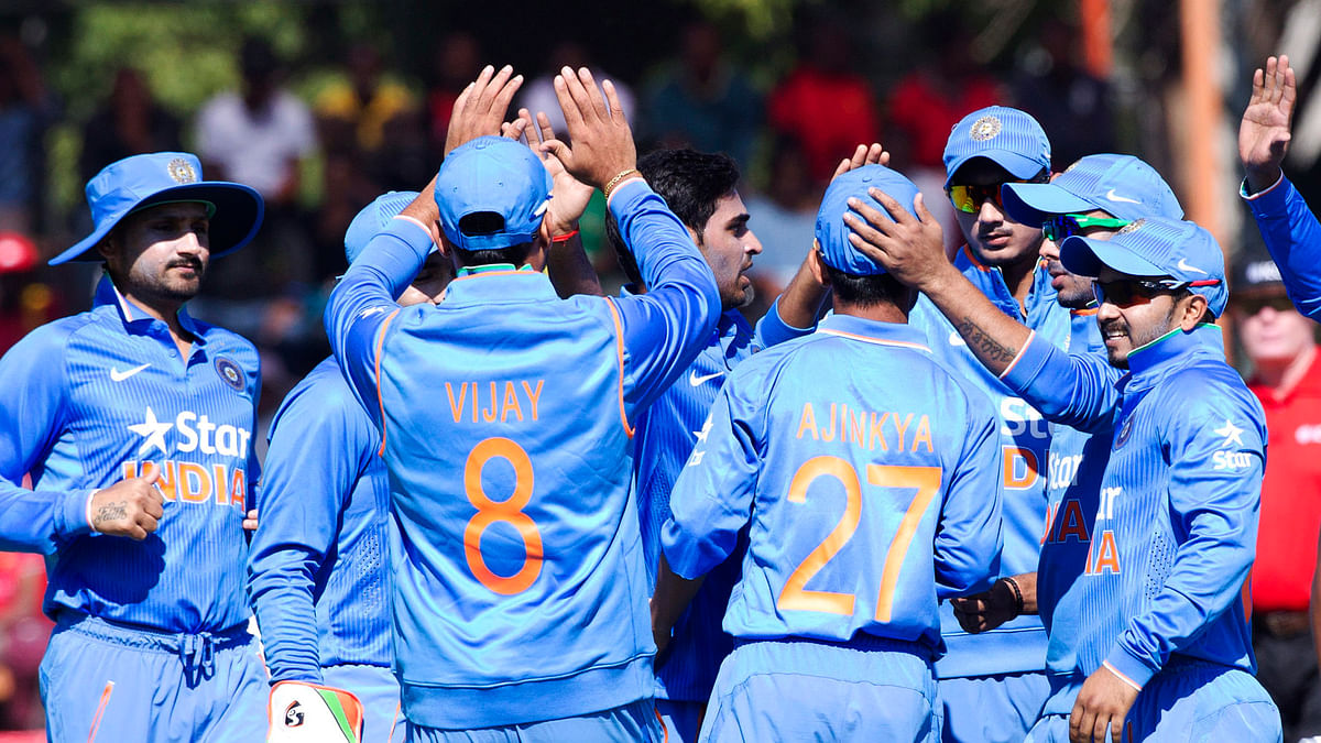 Indian cricket players  celebrate after dismissing Zimbabwean batsman Chamunorwa Chibhabha during the first ODI in Harare. (Photo: AP)