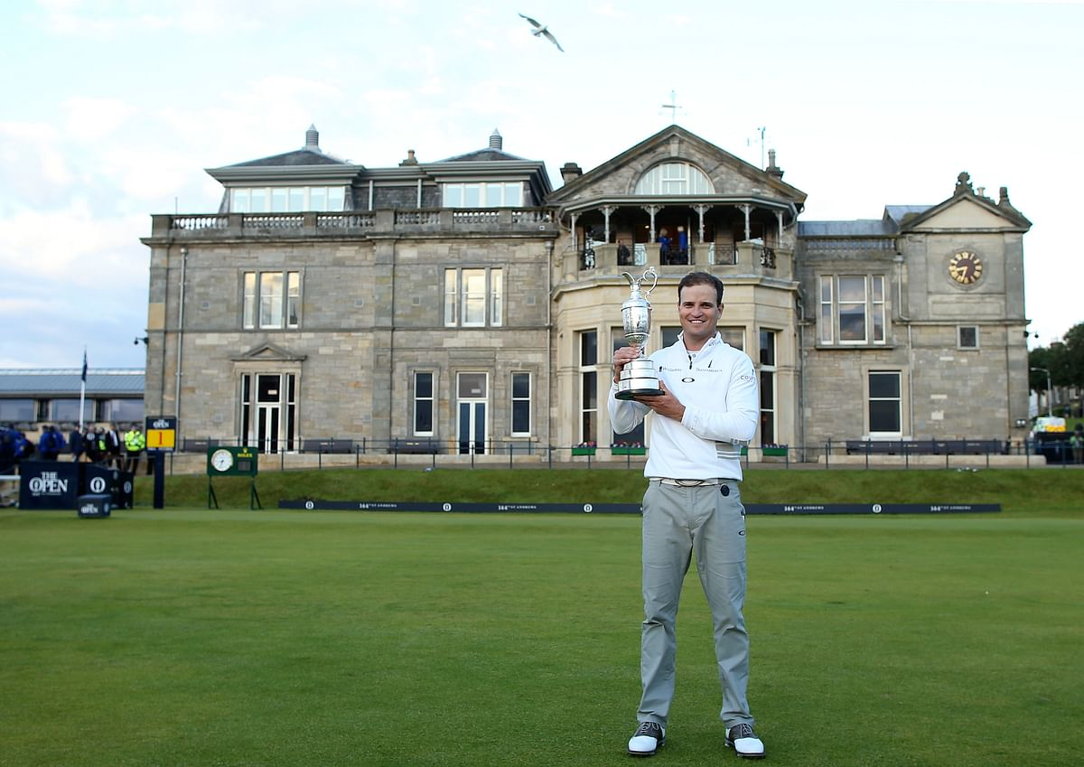 Zach Johnson poses with the trophy after winning a play-off after the final round at the British Open. (Photo: AP)