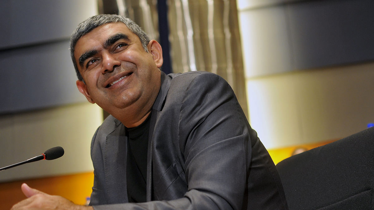 Infosys Chief Executive Vishal Sikka smiles during the announcement of the company's first quarter results at its headquarters in Bengaluru July 21, 2015. Indian IT services provider Infosys Ltd on Tuesday said a business revamp initiated by its first non-founder boss helped it win more large deals in the first quarter, fuelling a 5 percent rise in net profit. (Photo: Reuters(