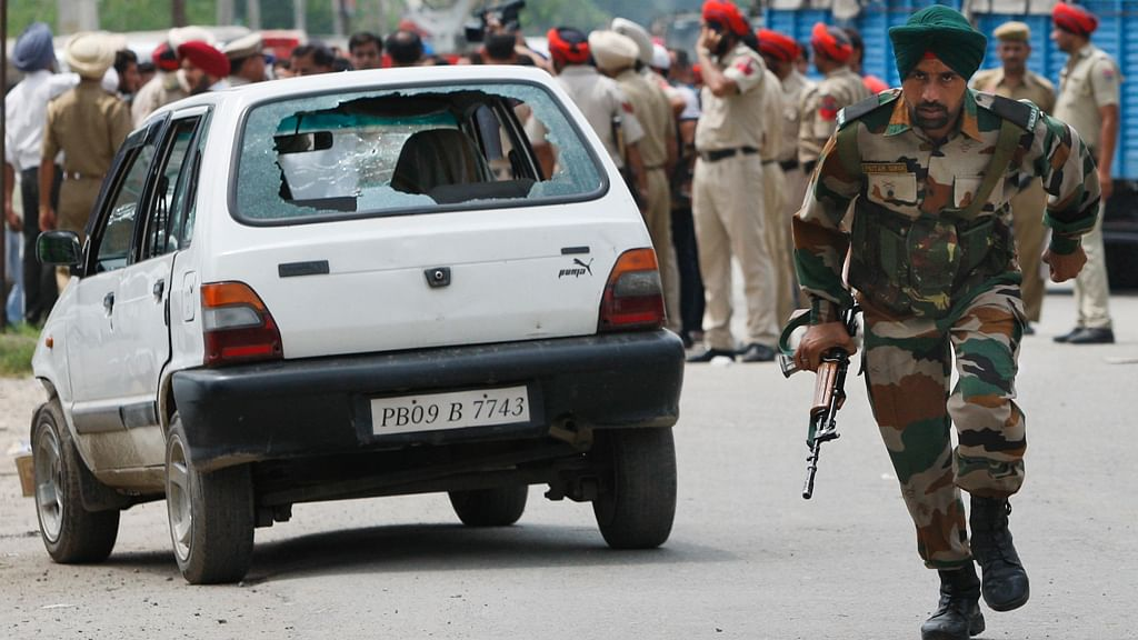 Security forces inGurdaspur on Monday morning. (Photo: PTI)