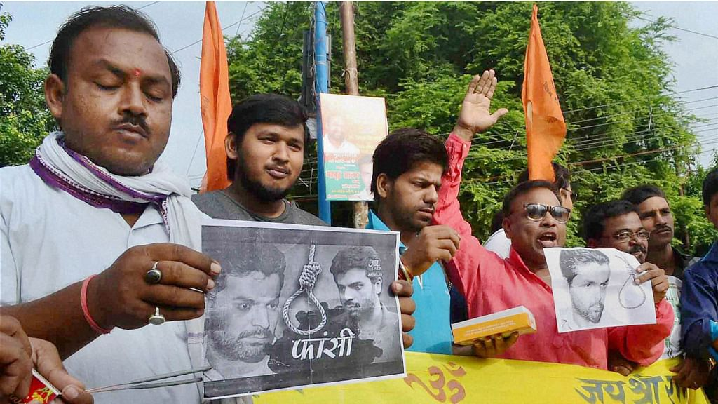 The judges in Yakub Memon's case held that the death warrant issued by the TADA court on April 30 suffered from no legal infirmity. Vishwa Hindu Parishad workers celebrate Yakub Memon's hanging in Allahabad, July 30, 2015. (Photo: PTI)