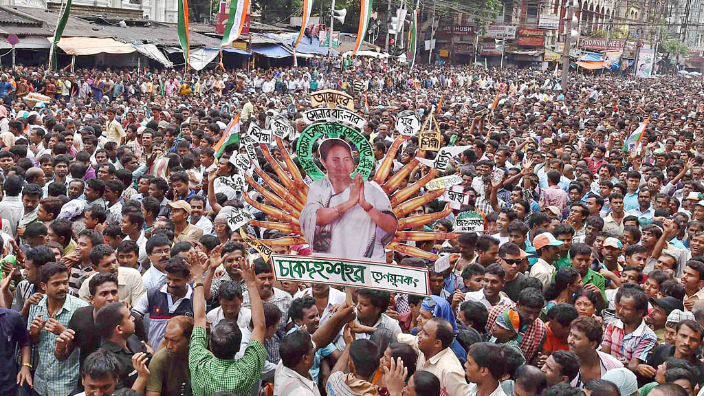 TMC activists hold up Mamata Banerjee's cut-out during the rally. (Photo: PTI)