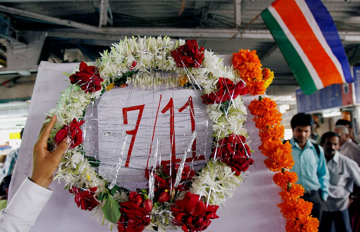A man lays a wreath on a memorial. Seven bombs went off in Mumbai killing at least 183 people. (Photo: Reuters)