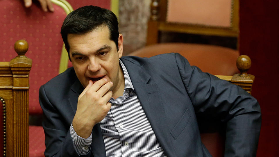 Greece's Prime Minister Alexis Tsipras reacts during a parliament meeting in Athens. (Photo: AP)