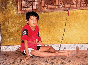 "2015: 12-year old boy, Iyarn, is chained in his home in Somnath district for the past six years. Mentally challenged Iyarn is chained at home to prevent him from escaping when his family members are out for work (Photo: <a href=""http://www.afternoondc.in/nation/chained-for-the-past-six-years/article_143267"">Afternoon Despatch &amp; Courier</a>)"