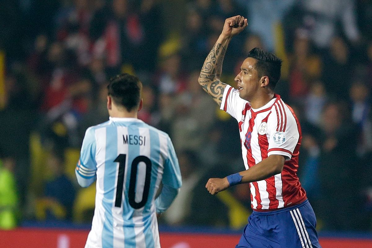 Paraguay's LucasBarrios, right, celebrates after scoring against Argentina. (Photo: AP)<a></a>